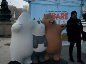 Photo of We Bare Bears models, with human helper.
